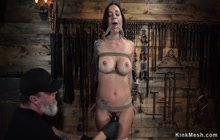 Brunette in rope bondage gets whipped