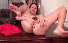 Horny MILF fingers her hairy pussy