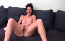 French mature Emanuelle strips and masturbates
